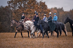 Horse-hunting with ladies in riding habit. Costumes. Historical reconstruction of famous XIXth century russian hounds hunting by horse club Avanpost Stock Photos