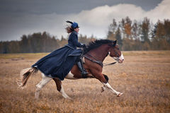Horse-hunting with ladies in riding habit. Costumes. Historical reconstruction of famous XIXth century russian hounds hunting by horse club Avanpost Royalty Free Stock Photo