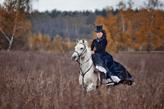 Horse-hunting with ladies in riding habit. Costumes. Historical reconstruction of famous XIXth century russian hounds hunting by horse club Avanpost Stock Images
