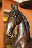 Horse. Image of a small carved wooden horse with background Royalty Free Stock Photography