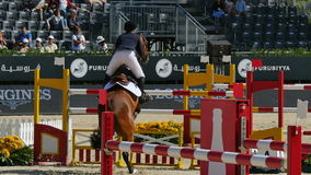 Horse International Jumping Fences Competition. Horseback riders jumping hurdles. Jockeys in an International competition. International jumping competition in