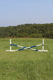 Horse Jump Cross Bar Equestrian. Blue and white pvc crossbar horse jump set Stock Images