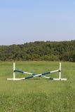 Horse Jump Cross Bar Equestrian. Blue and white pvc cross bar jump set Royalty Free Stock Photo