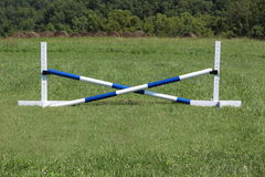 Horse Jump Cross Bar Equestrian. Blue and white jump set.  Crossbars are pvc Royalty Free Stock Photo