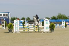 Horse jump at the equitation contest. In Bucharest stock image