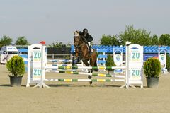 Horse jump at the equitation contest. In Bucharest stock photo
