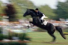 Horse jumping. At an equestrian competition Stock Image