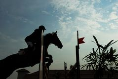 Horse jumping. A show jump horse trying to overcome hurdles at Premiercup Equestrian event in Putrajaya Malaysia Royalty Free Stock Photo