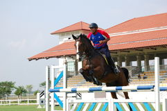 Horse Jumping. A contester performing jumping dicipline in a competetion.  The pre selection competition was held on March 28, 2008 at Putrajaya Equestrian Park Royalty Free Stock Photos