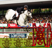 Horse jumping competition Stock Image