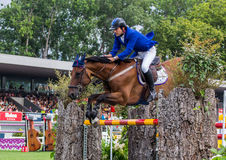 Horse jumping competition Stock Photos