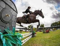 Horse jumping competition Stock Photography
