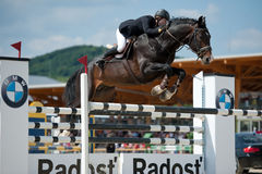 Horse jumping competition in Pezinok, Slovakia. PEZINOK, SLOVAKIA – MAY 29: Veronika JELÍNKOVÁ on horse  FOREVER (CZE) jumps over a hurdle at SHARON Grand Stock Images
