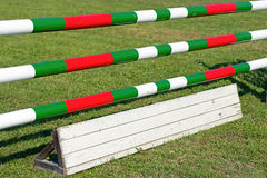 Horse Jumping Hurdle. Equestrian Sports. Green, Red and White Royalty Free Stock Photos