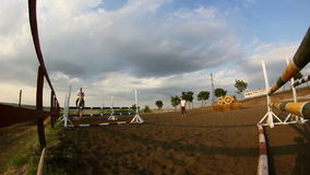 Horse jumping obstacles in slomo Stock Photography