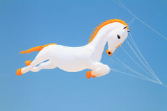 Horse kite against blue sky Stock Photography