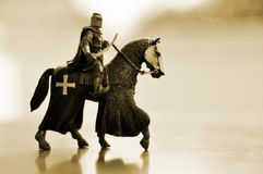 Horse knight. Toy statue of knight on horseback sepia tone Royalty Free Stock Images