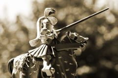 Horse knight. Toy statue of knight jousting on horseback royalty free stock photography