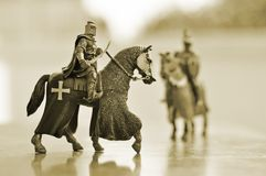 Horse knights. Toy statues of knights on horseback sepia tone stock photos