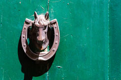 Horse knocker on a green background. Detail of horse knocker on a green background stock photos