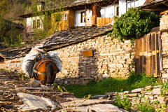 Horse laden with bags in Leshten village, Bulgaria Royalty Free Stock Images