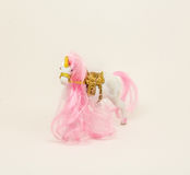 Horse-lady. The little white horse with a big pink mane and a pink tail Royalty Free Stock Photos