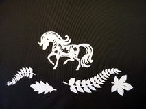 Horse and leaves. Paper cutting. Royalty Free Stock Photography