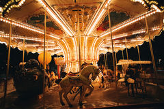 Horse of light carousel at night Stock Photos