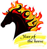 Horse with a mane of fiery. Horse, silhouette of symbol  2014 year with decorative writing Royalty Free Stock Photography