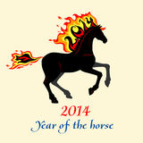 Horse with a mane of fiery. Horse, silhouette of symbol  2014 year with decorative writing Royalty Free Stock Photos