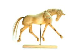 Horse mannequin trot. A wooden horse model in trot, over a white background Royalty Free Stock Images