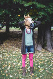 Horse mask woman in the park Royalty Free Stock Photos