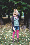 Horse mask woman in the park Stock Photos