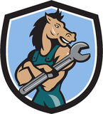 Horse Mechanic Spanner Crest Cartoon. Illustration of a horse mechanic with arms crossed holding spanner looking to the side set inside shield crest on Royalty Free Stock Photos