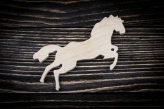 Horse on old wood background.  Stock Image