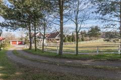 Horse paddock and house Royalty Free Stock Image