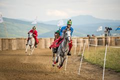 Horse parade ,during a horse show with young riders. Young horse riders on horses parade and contest , with costume Royalty Free Stock Image
