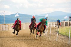 Horse parade ,during a horse show with young riders. Young horse riders on horses parade and contest , with costume Royalty Free Stock Photography