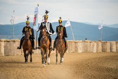 Horse parade during a horse show in with consummated horse riders. Horse parade during a horse show in Covasna county , Romania Stock Photography