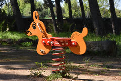 Horse in the park. Toy horse installed in a sadness garden for his abandonment Royalty Free Stock Photography