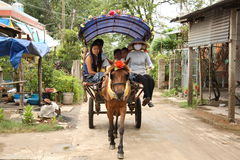 Horse and people in a cart in Vietnam village Royalty Free Stock Image