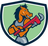 Horse Plumber Monkey Wrench Crest Cartoon. Illustration of a horse plumber arms crossed holding monkey wrench looking to the side set inside shield crest on Stock Image