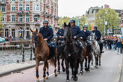 Horse police at Koninginnedag 2013. Koninginnedag or Queens Day was a national holiday in the Kingdom of the Netherlands until 2013. Celebrated on 30 April (the Stock Photography