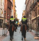 Horse police power in Madrid, Spain royalty free stock photo