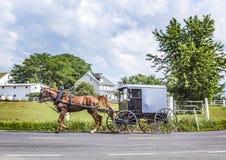 A horse pulling a cart across a beautiful Saskatchewan landscape Stock Images