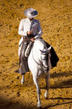 Horse of pure breed. Real equestrian gala Held on June 16 of 2012 in Jerez de la Frontera. Rider dressed with traditional dress riding a white horse of pure Stock Photography