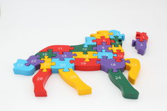 Horse puzzle. Made of wood and color Stock Images
