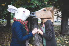 Horse and rabbit mask women in the park Royalty Free Stock Images