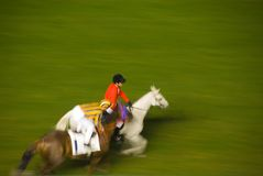 Horse race. Before the race - two jockeys with their horses galloping to the start Stock Image