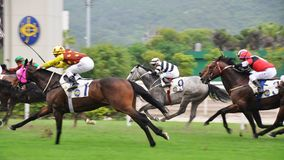 Horse race. In full swing. Photo in HongKong stock images